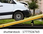 Small photo of Crashed car is immersed in tow truck closeup. Car evacuation after an accident concept