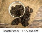 Dried Prunes In A Metal Bowl...