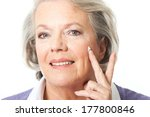 woman putting cream on a the... | Shutterstock . vector #177800846