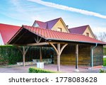 Wooden Carport With Red Brick...