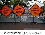 Small photo of Washington, DC – July 17, 2020: Black Lives Matter protest warning signs on the hastily constructed fence at Lafayette Park that now blocks access to the White House.