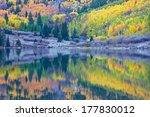 Reflection of fall foliage at Maroon Bells, Aspen, Colorado - stock photo