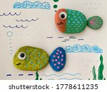 Two Funny Fish Are Drawn On Se...
