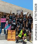 Small photo of ALMERIA, SPAIN - Jun 14, 2020: June 14 of 2020, a group of afro protesters against racism with the motto of black lives matter. In Roquetas de Mar, Almeria, Andalucia, Spain.