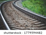 Small photo of Rounded railway rails extending into the distance. Curved rails. Slewing rails. Selective focus.