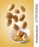 Potatoes Flying Over White Bowl