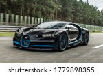 Small photo of London, England-November 20,2019: A black BUGATTI CHIRON Superfast sports car is driven on road