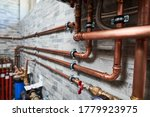 Small photo of Plumbing service. copper pipeline of a heating system in boiler room