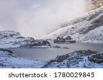 Balea lake surrounded by snowy...