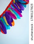 colored feathers on a white... | Shutterstock . vector #1780127825