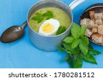 Ladle With A Portion Of Green...