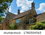 Top Floor And Tiled Roof Of An...