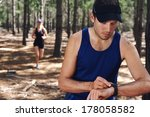 trail running couple check time ... | Shutterstock . vector #178058582