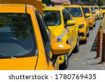 Yellow Taxi Cars On The Empty...