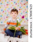 beautiful boy with tulips | Shutterstock . vector #178087625
