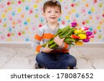beautiful boy with tulips | Shutterstock . vector #178087652