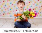 beautiful boy with tulips   Shutterstock . vector #178087652