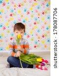 beautiful boy with tulips   Shutterstock . vector #178087706