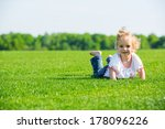 cute smiling little girl lying...   Shutterstock . vector #178096226