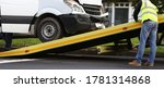 Small photo of Crashed minibus is loaded onto tow truck after an accident. Evacuation and towing services concept