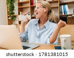 Image Of Happy Woman Using...