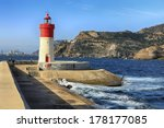 Red And White Lighthouse At Th...