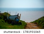 A Small Wooden Boat Is Left On...