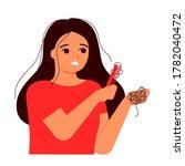 girl combs her hair  hair on...   Shutterstock .eps vector #1782040472