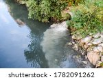 Sewage Drains Into The River....
