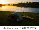 Rafting On Kayaks. A Tent Camp...