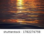 Mediterranean sea at sunrise. Golden sunlight reflecting in the water. Abstract natural pattern, texture, background, seascape, concept image, graphic resources