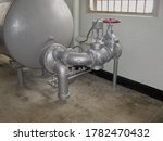 Old Pipe Work And Tank In An...