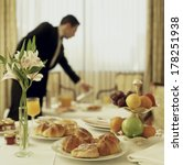 Stock photo big hotel room service continental breakfast with waitress out of focus 178251938