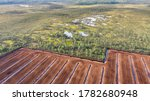 Aerial view to the bog landscape with the remaining natural elements and destroyed area by peat extraction. This  activity have severe impact to water protection, biodiversity and climate change