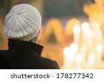 Young Female Looking At Candle...