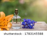 Perfume Bottle With Flowers On...
