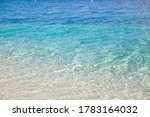 Aerial footage of a perfectly crystal clear blue turquoise water. Transparent turquoise sea water, natural background. Summer and travel vacation concept. - stock photo