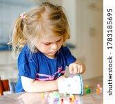 Little Toddler Girl Making...