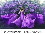 Fashion model in lilac flowers  ...