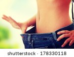 woman showing how much weight... | Shutterstock . vector #178330118