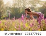 beautiful young woman in purple ... | Shutterstock . vector #178377992