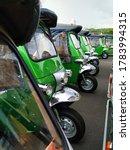 Small photo of Tuk tuk cars, three wheel cars at park. Tuk tuk is traditional tricycle wheeler car and symbol of taxi in Thailand travelling in Bangkok.
