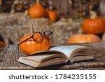 Halloween Pumpkin On A Wooden...