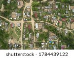 Top view of the grid of streets and roads in the village with houses. Map of the area, photograph from the drone.