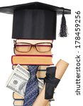 Small photo of Joky image of the successful student: books, eyeglasses, mortarboard, money