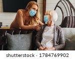 Senior Woman In Medical Mask...