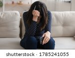 Distressed Young Woman Hold...