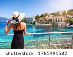 A Tourist Woman With Sunhat...