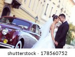 Bride And Groom Near Vintage Car
