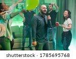 Cheerful Bald Man Doing Karaoke ...